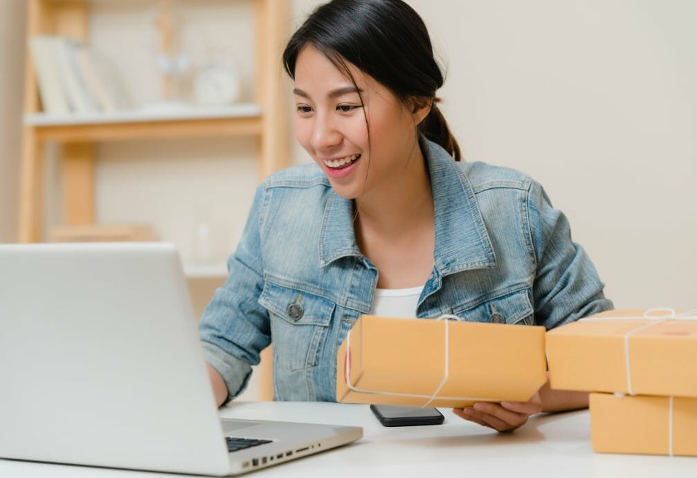 beautiful smart asian young entrepreneur business woman owner sme online checking product stock save computer working home